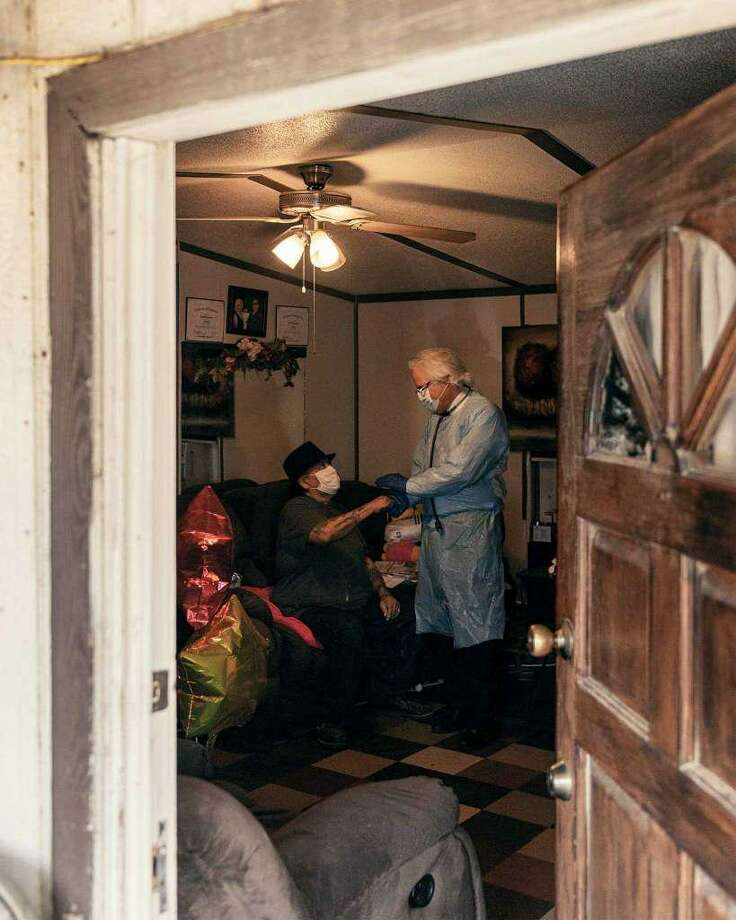 Dr. Ricardo Cigarroa visits Natividad Santana at his home in the Cuatro Vientos neighborhood of Laredo on April 28, 2020. Courtesy of Texas Monthly Photo: Josh Huskin /Texas Monthly