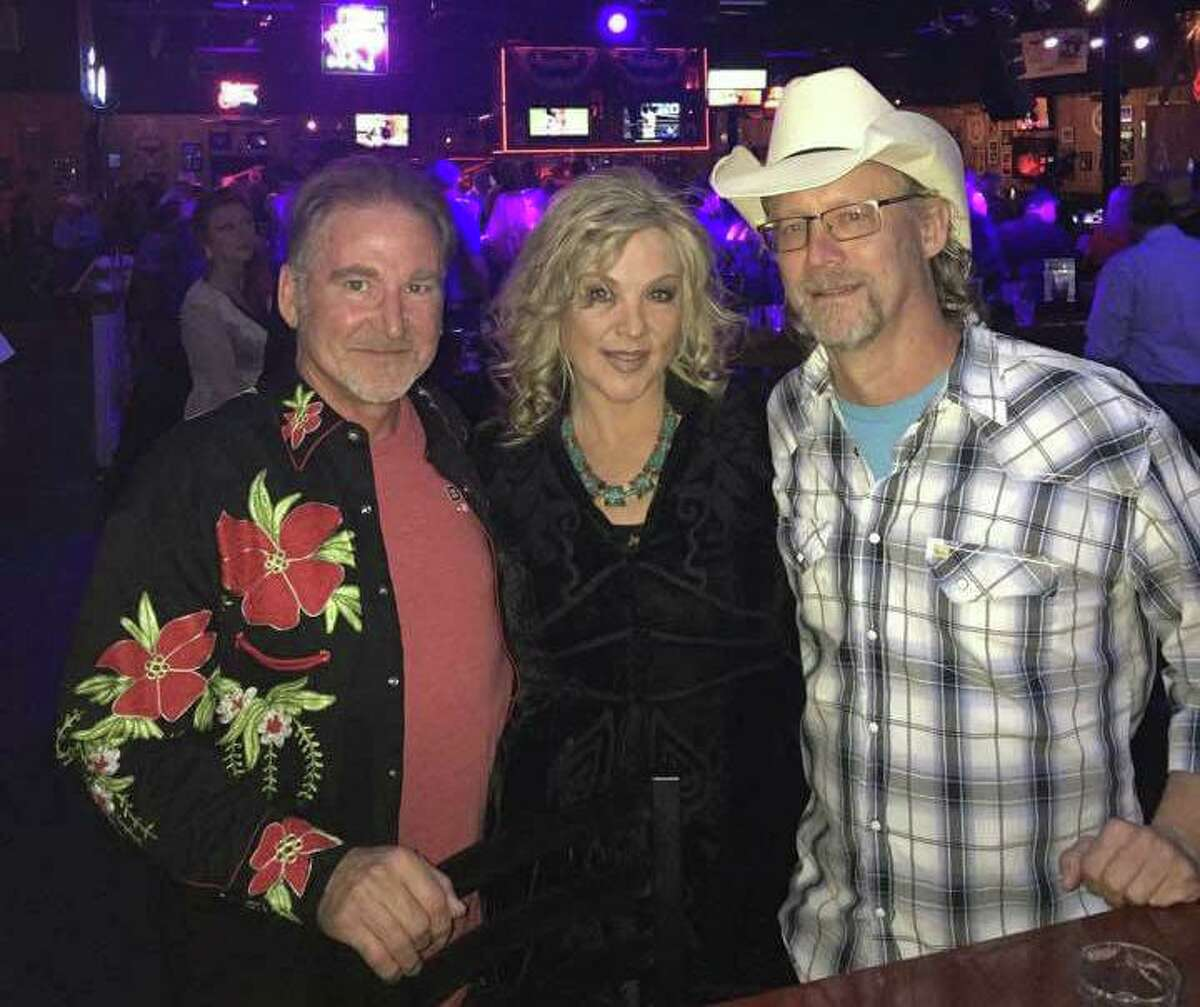 Debbie Glenn, center, with her bandmates from Southern Disposition. The group will perform at Bo's Extravaganza hosted by John Schneider (Dukes of Hazard) in Holden, Louisiana July 18-19.