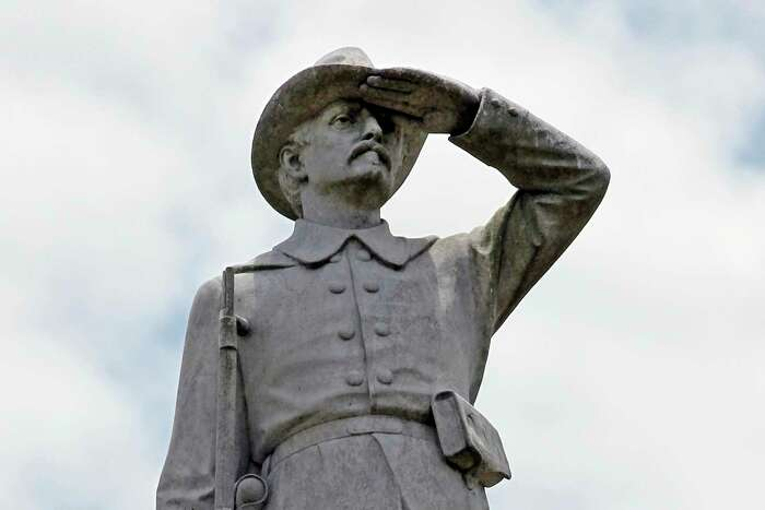 The statue of a rebel soldier has looked steadfastly northward from his sentry post atop a tall pedestal in a Gonzales park since 1909. Some now want it removed.