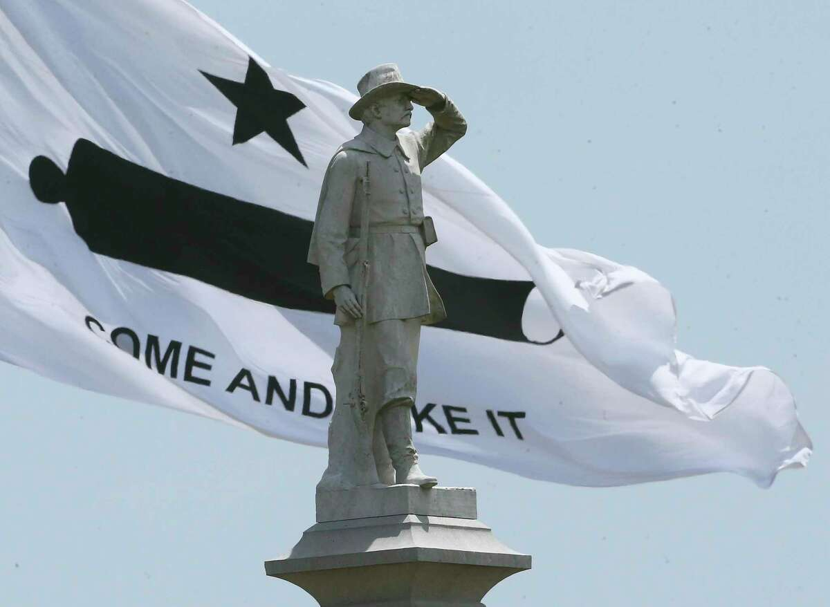 The Come and Take It flag waves in the background behind the Confederate Square statue.