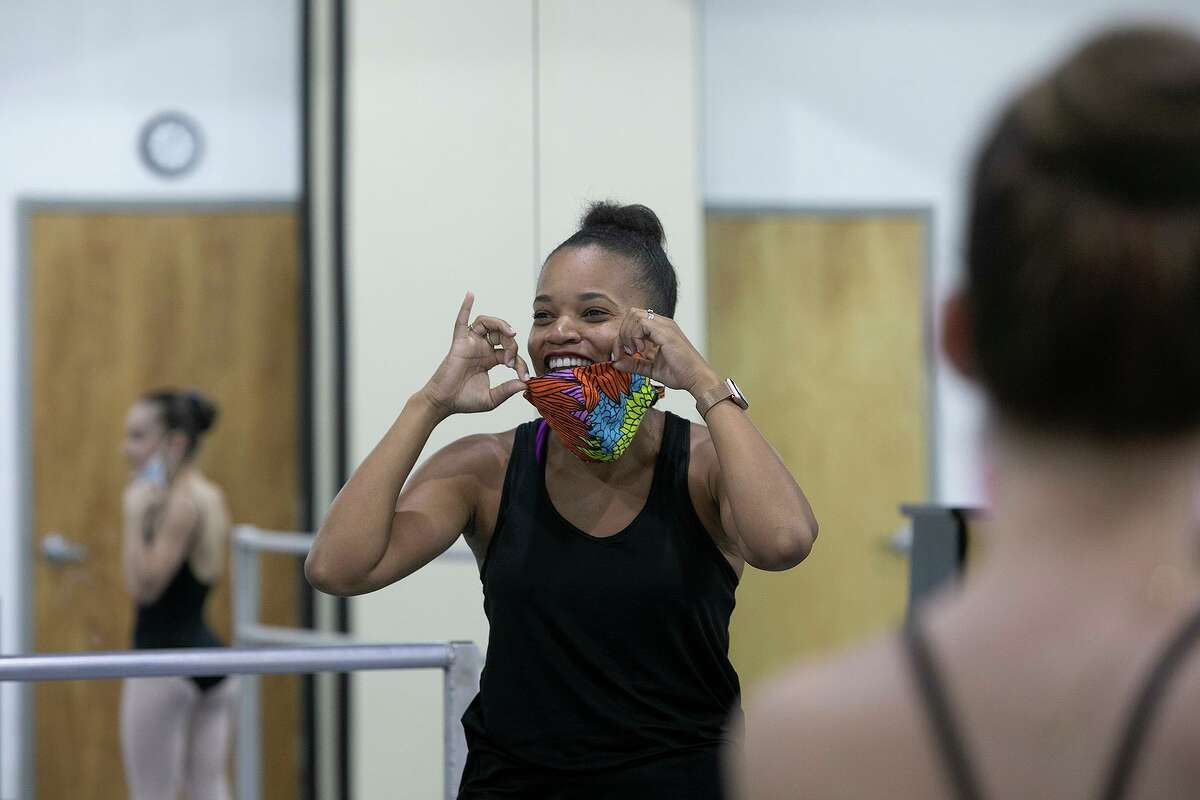 San Antonio Ballet School director Danielle Campbell Steans and students take a quick mask break to catch their breath during a class.