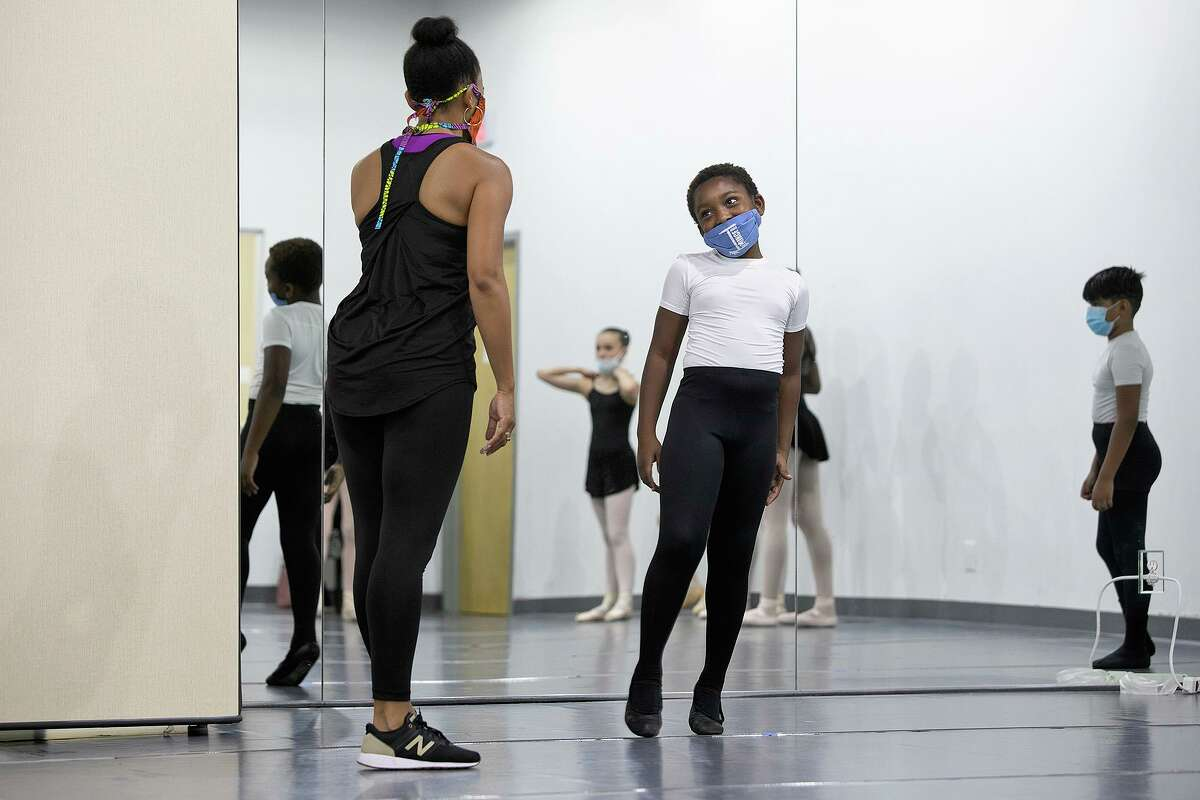 San Antonio Ballet School director Danielle Campbell Steans talks with student Prince Hightower, 10, during a class at the school.