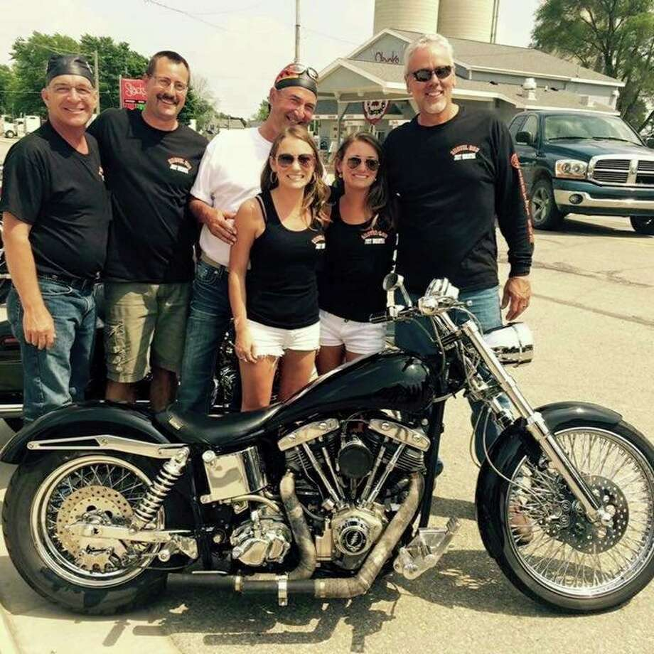 Shovel Run Group members Randy Elenbaum, Jason Gorsegner, Kevin Buchholz, and Larry Leipprandt are shown here at the 2019 Shovel Run with Tom Gettel's twin daughters Erin and Kate, who come every year they can. (Courtesy Photo)