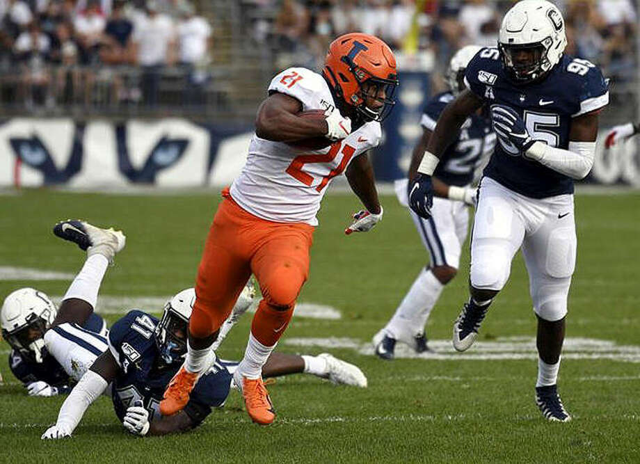 Illinois running back Ra'Von Bonner (21) breaks free of Connecticut linebacker D.J. Morgan (41) for a touchdown during last year's game in East Hartford, Conn. There will be no return game this fall, with the Big Ten moving to a conference-only football schedule for the 2020 season. Photo: File Photo