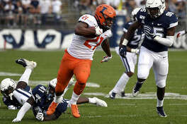 Illinois running back Ra'Von Bonner (21) breaks free of Connecticut linebacker D.J. Morgan (41) for a touchdown during last year's game in East Hartford, Conn. There will be no return game this fall, with the Big Ten moving to a conference-only football schedule for the 2020 season.