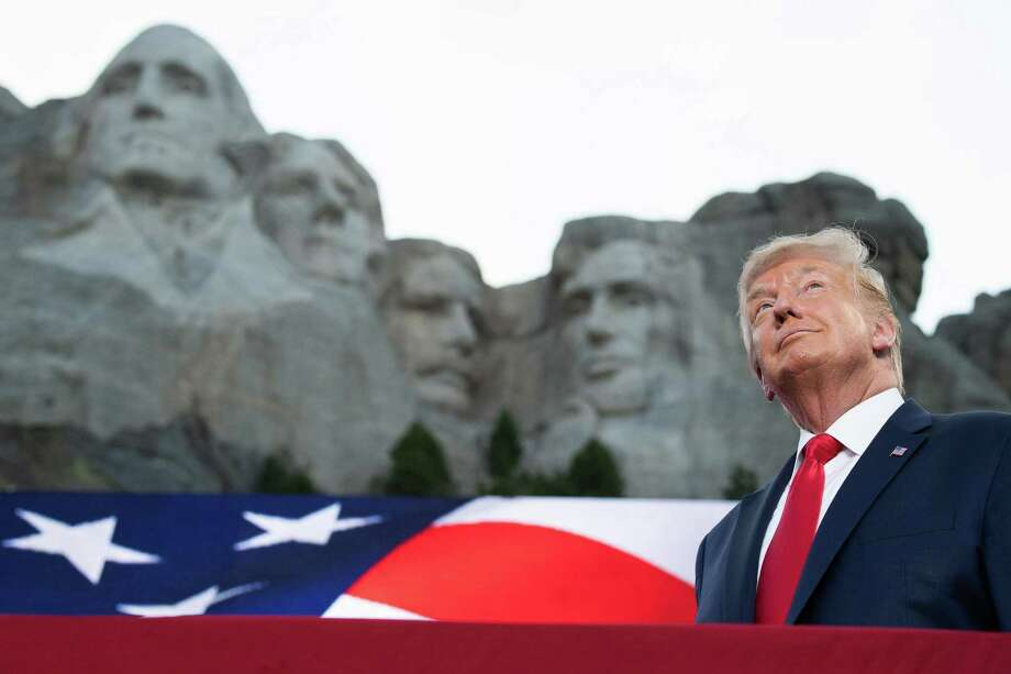 President Donald Trump poses in front of Mount Rushmore for his July 3 event in Keystone, S.D. Photo: SAUL LOEB/AFP, HO / TNS / Getty Images North America