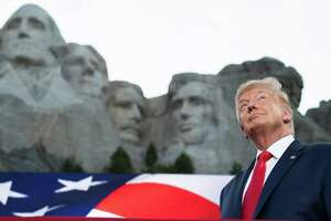 President Donald Trump poses in front of Mount Rushmore for his July 3 event in Keystone, S.D.