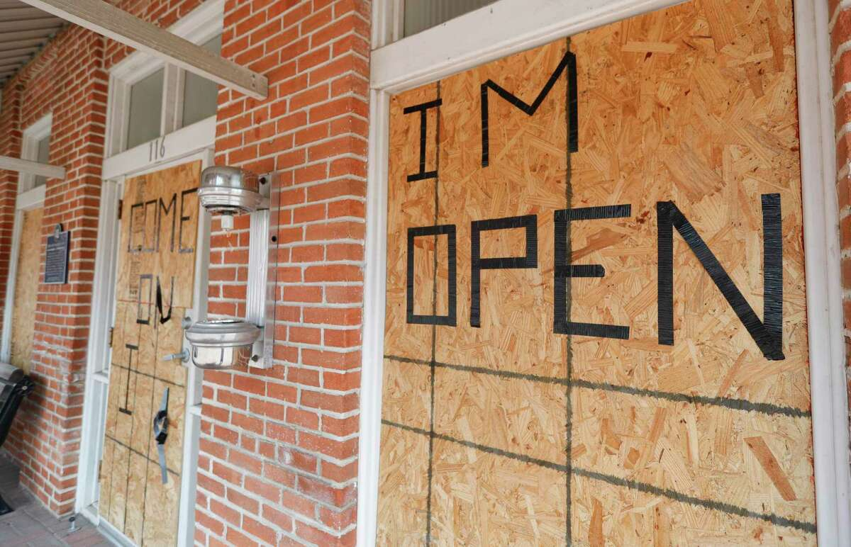 Boarded up windows are seen after a man broke several windows and damaged the inside of Shephard's Barber Shop overnight causing $6,000 worth of damage, Friday, July 10, 2020, in Conroe.