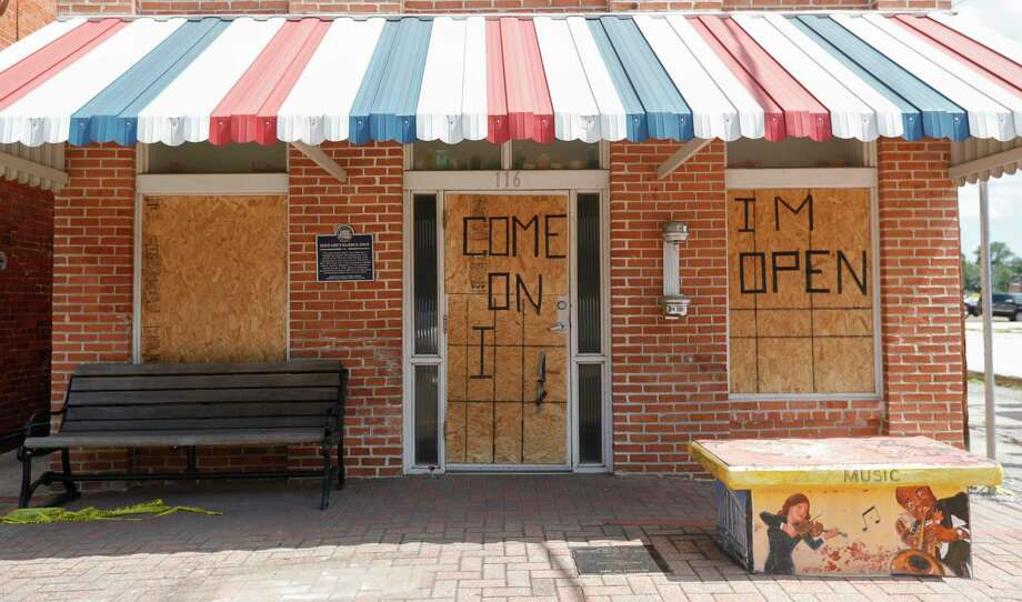 Damage is seen to Shephard's Barber Shop after a man broke several windows and damaged the inside of the 108-year-old business overnight causing $6,000 worth of damage, Friday, July 10, 2020, in Conroe. Photo: Jason Fochtman, Houston Chronicle / Staff Photographer / 2020 © Houston Chronicle