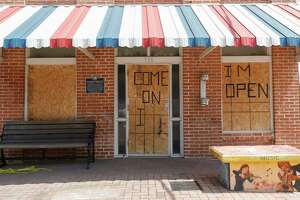 Damage is seen to Shephard's Barber Shop after a man broke several windows and damaged the inside of the 108-year-old business overnight causing $6,000 worth of damage, Friday, July 10, 2020, in Conroe.