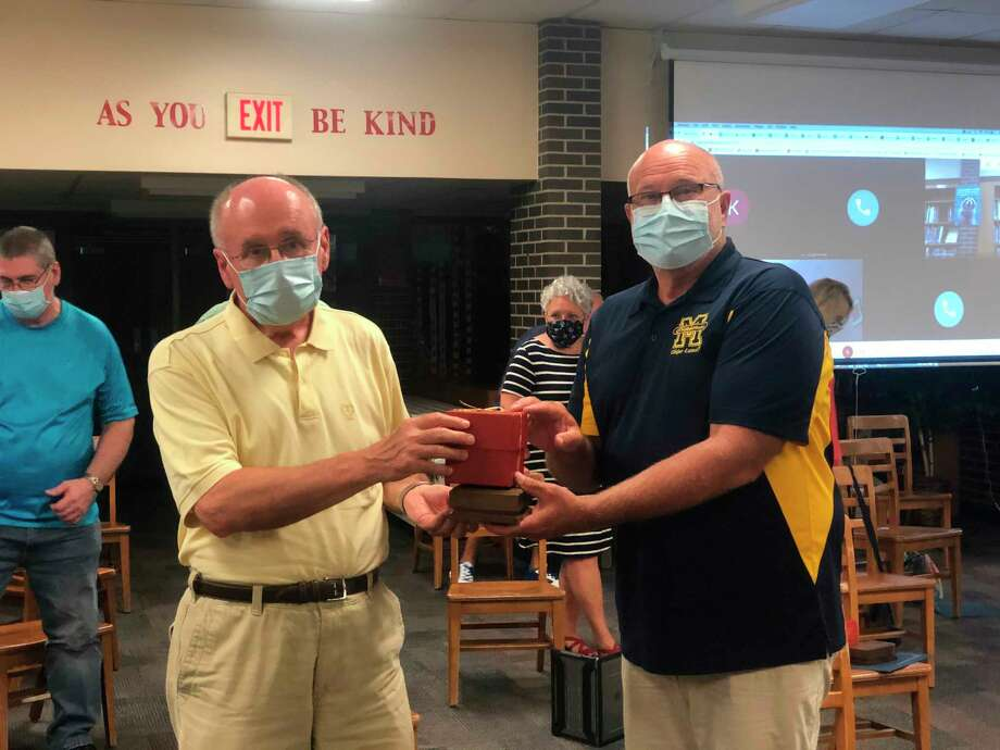 News Advocate associate editor Ken Grabowski (left) was honored on Wednesday by Manistee Area Public Schools. Superintendent Ron Stoneman presented him withthe Golden Apple Award. Grabowski retired on Friday.