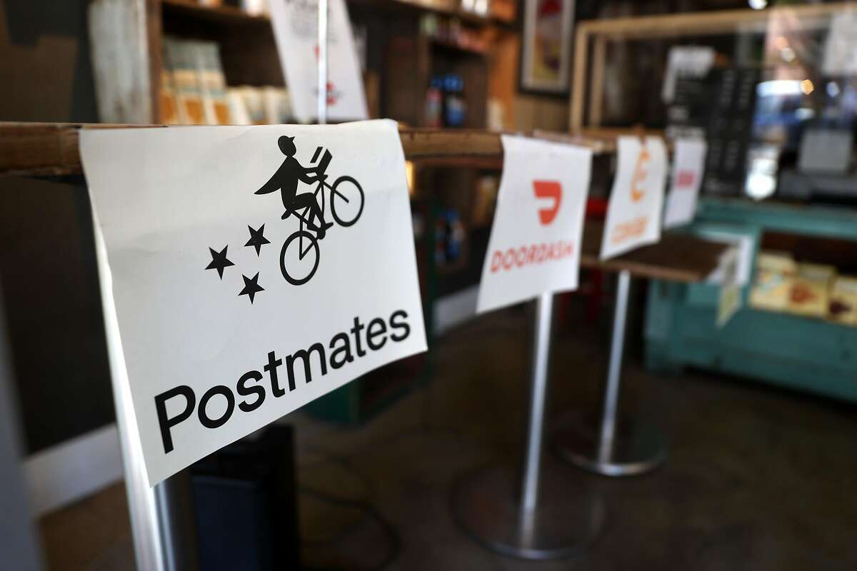 Postmates has joined other gig companies in charging customers' fees to pay for the costs of Proposition 22, a law that kept gig workers as independent contractors but provided for some new benefits.