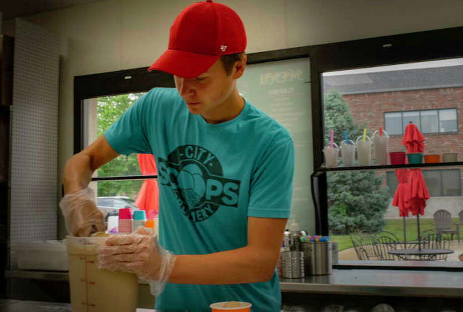 A City Scoops Creamery worker scoops a cup of their homemade coffee chip ice cream on Wednesday, during its second day of operation at the new Edwardsville location. Photo: Tyler Pletsch | The Intelligencer
