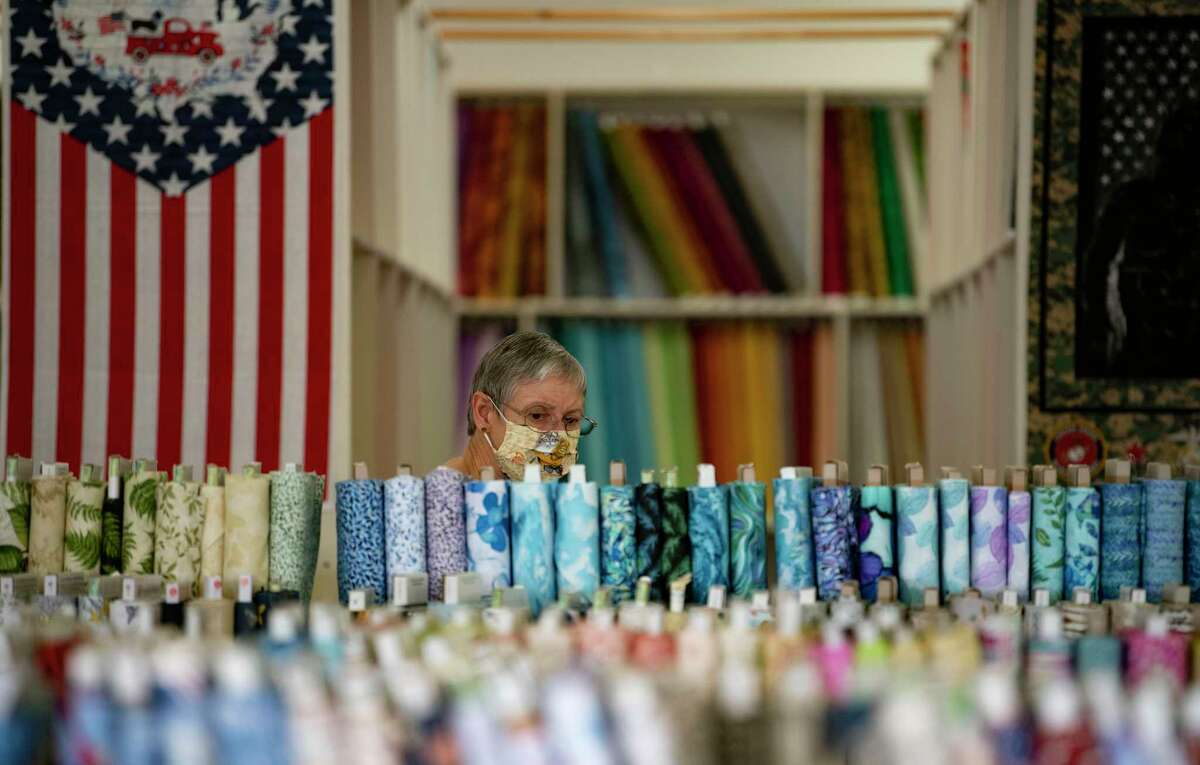 April Rippel of Seguin, who has sewn over 3,000 masks during the coronavirus pandemic, shops for cloth at Allbrands.com Creative Sewing Center. Like bicycles, home exercise equipment and televisions, sewing machines have become hard-to-find pandemic must-haves.