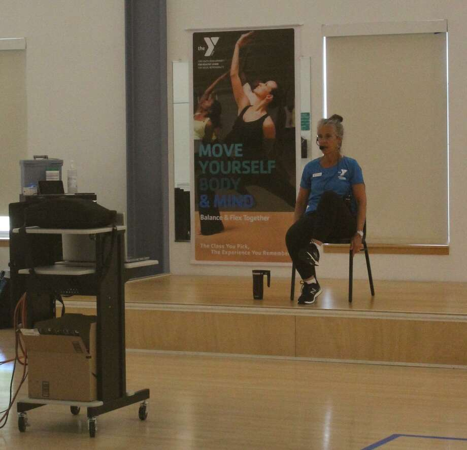 New Canaan YMCA instructor Deb Cardamone teaches a virtual chair yoga class. Photo: New Canaan YMCA