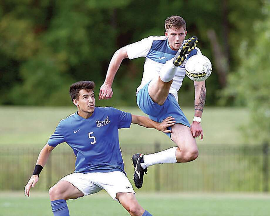 LCCC's Darcy Madden, right, goes high in action against Southwestern Illinois College at Tim Rooney Field. Men's and women's soccer and women's volleyball seasons could be switched to next spring instead of this fall because of the COVID-19 pandemic,. Photo: Jan Dona | For The Telegraph