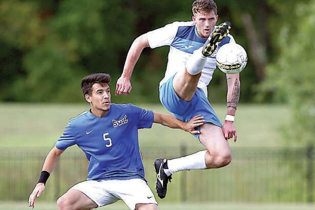 LCCC's Darcy Madden, right, goes high in action against Southwestern Illinois College at Tim Rooney Field. Men's and women's soccer and women's volleyball seasons could be switched to next spring instead of this fall because of the COVID-19 pandemic,.