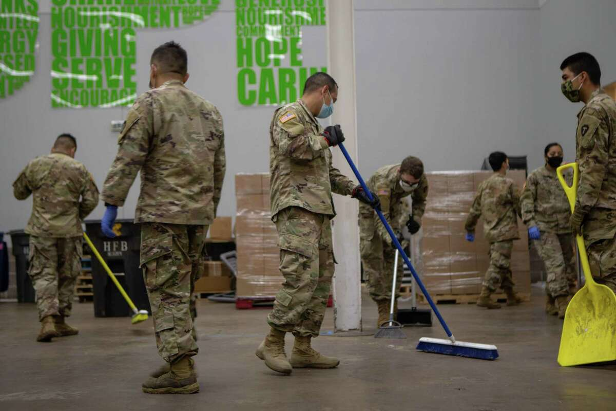 Members of the National Guard sweep up after their shift at the Houston Food Bank on Thursday, July 9, 2020. The guards men and women work from around 8:00 a.m. until noon.