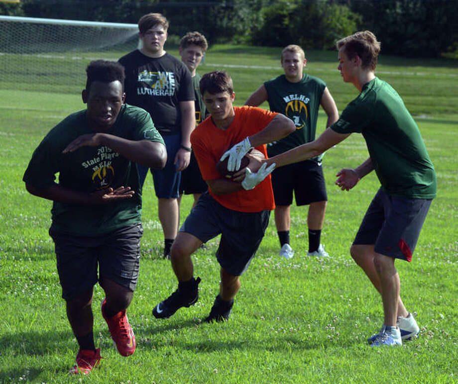 Metro-East Lutheran football players perform non-contact drills during practice on Wednesday afternoon. Photo: Scott Marion/The Intelligencer