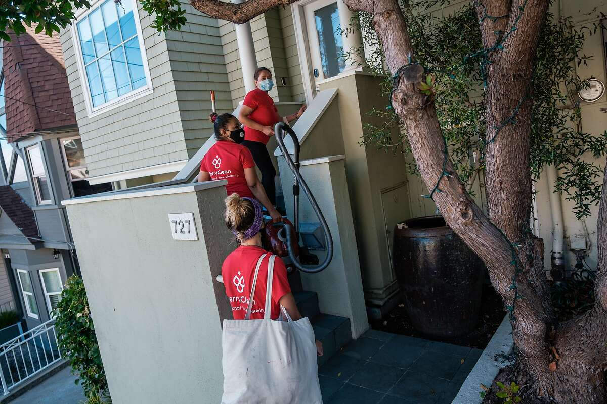 A Cleaning crew with BerryClean head toward a residential property in San Francisco on Friday, July 10, 2020.