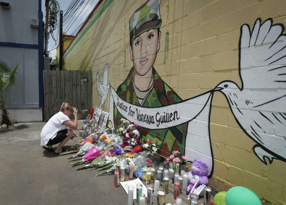 """Marcia Peña blessed herself as she paid her respects to Vanessa Guillen at a mural painted by Alejandro """"Donkeeboy"""" Roman Jr. on the side of Taqueria Del Sol, 8114 Park Pl. Blvd. Thursday, July 2, 2020, in Houston."""