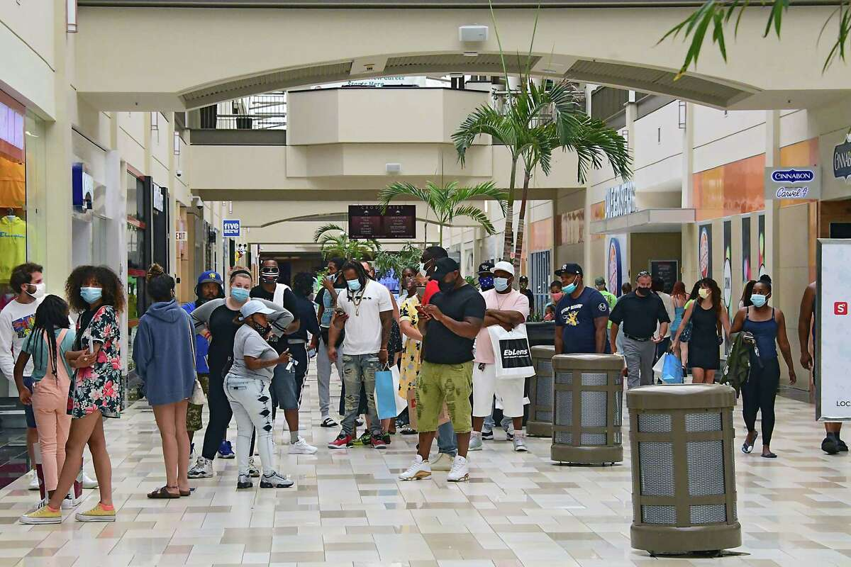 A line is formed outside of the Jimmy Jazz store as Crossgates Mall reopened public spaces on Friday July 10, 2020 in Guilderland, N.Y. Local malls can open their interior public spaces after the governor gave the go-ahead if the HVAC system meets certain standards for filtering out Covid-19.