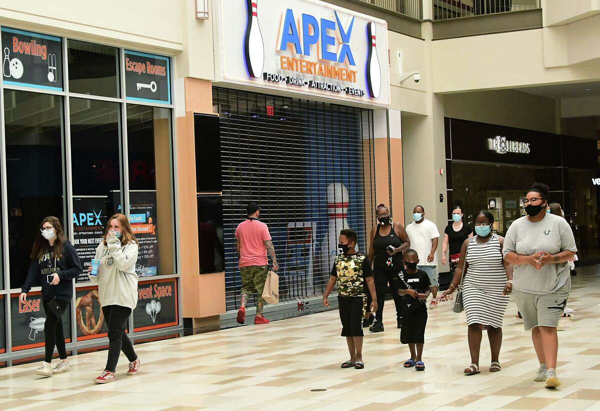 People shop as Crossgates Mall reopened public spaces on Friday July 10, 2020 in Guilderland, N.Y. Local malls can open their interior public spaces after the governor gave the go-ahead if the HVAC system meets certain standards for filtering out Covid-19.