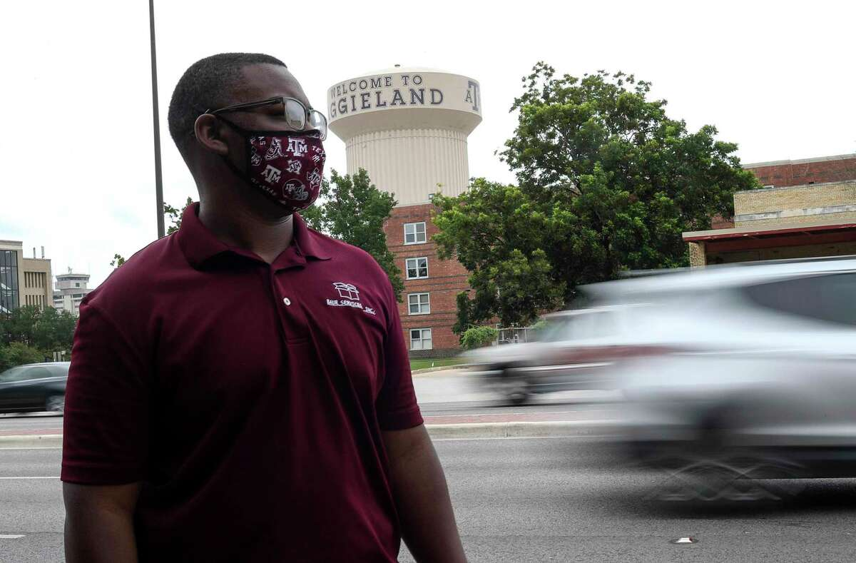 """Joseph Collins looks out at passing cars on University Drive on Tuesday, July 7, 2020, at Texas A&M University in College Station. Collins said that a man yelled a racial slur at him from a passing car at the same location as he walked to work in early June. """"Does he care that I'm a human being behind the flesh boundary that is my skin?"""" Collins asked. """"There's a Bible verse that says love your enemies and pray for those who persecute you,"""" he said. """"All I can do is pray for the man who yelled those things at me and hope love will replace that hate in his heart."""""""