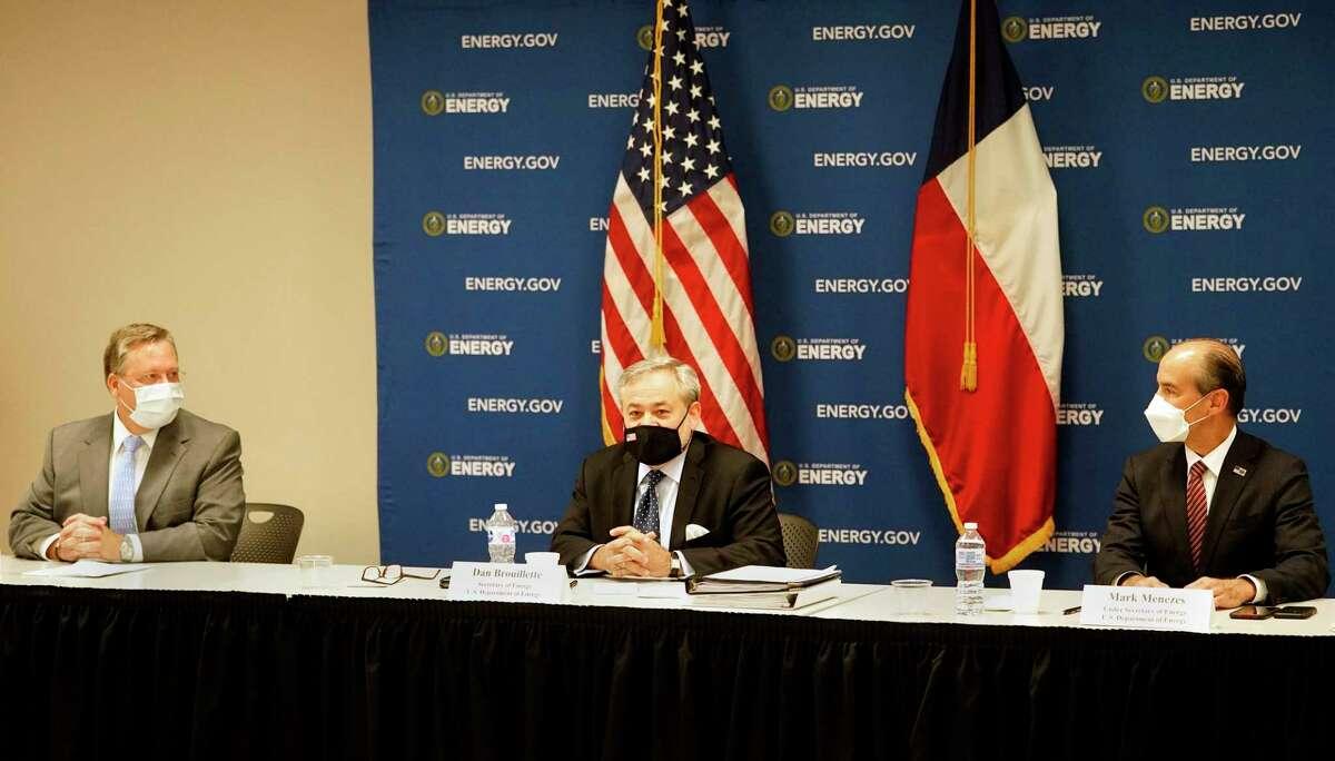 Steve Hinchman, chairman Independent Petroleum Association of America, left, and Mark W. Menezes, Under Secretary of Energy, right, listen as U.S. Energy Secretary Dan Brouillette, center, speaks to the media at Houston Energy, 1200 Smith St., Friday, July 10, 2020, in Houston.