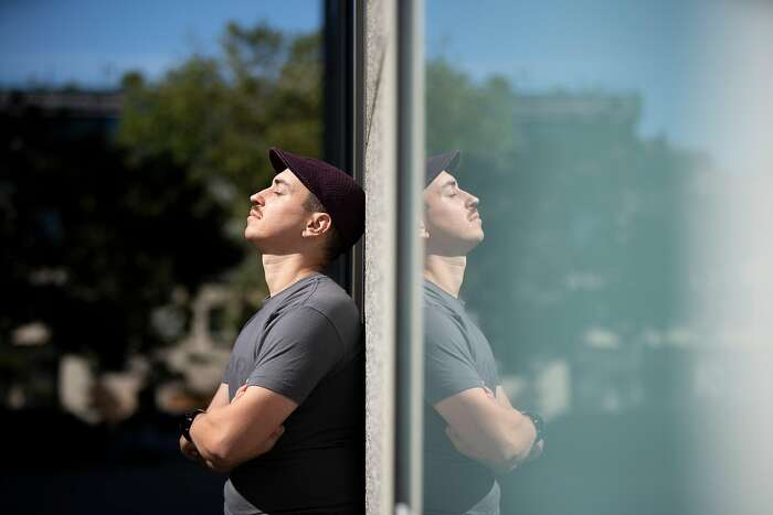 A portrait of Alexey Komissarouk in his neighborhood on Thursday, June 18, 2020, in Oakland, Calif. Komissarouk, who is from Israel, is in the U.S. on an H-1B work visa. He got laid off during the pandemic and had 60 days to find a new job or else leave the country, under the terms of his work visa. He found a new job in time.