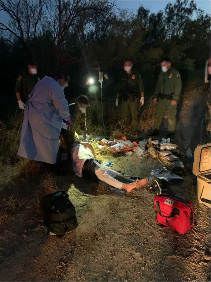 U.S. Border Patrol agents are seen rendering aid to an immigrant who got lost while entering the country illegally. Photo: Courtesy