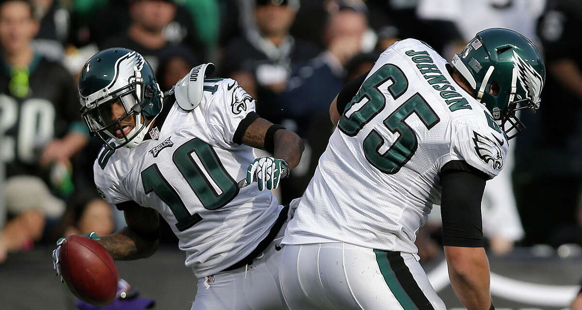 Philadelphia Eagles wide receiver DeSean Jackson (10) celebrates with offensive tackle Lane Johnson (65) after scoring on a 46-yard touchdown pass from quarterback Nick Foles during the third quarter of an NFL football game against the Oakland Raiders in Oakland, Calif., Sunday, Nov. 3, 2013. (AP Photo/Marcio Jose Sanchez)
