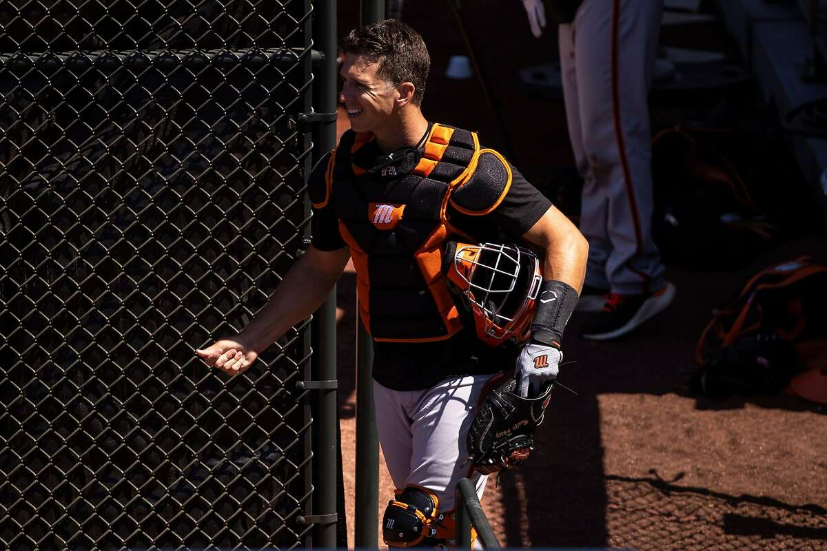 Buster Posey #28 of the San Francisco Giants walks in the outfield during summer training camp at Oracle Park in San Francisco, Calif. on Monday, July 6, 2020.