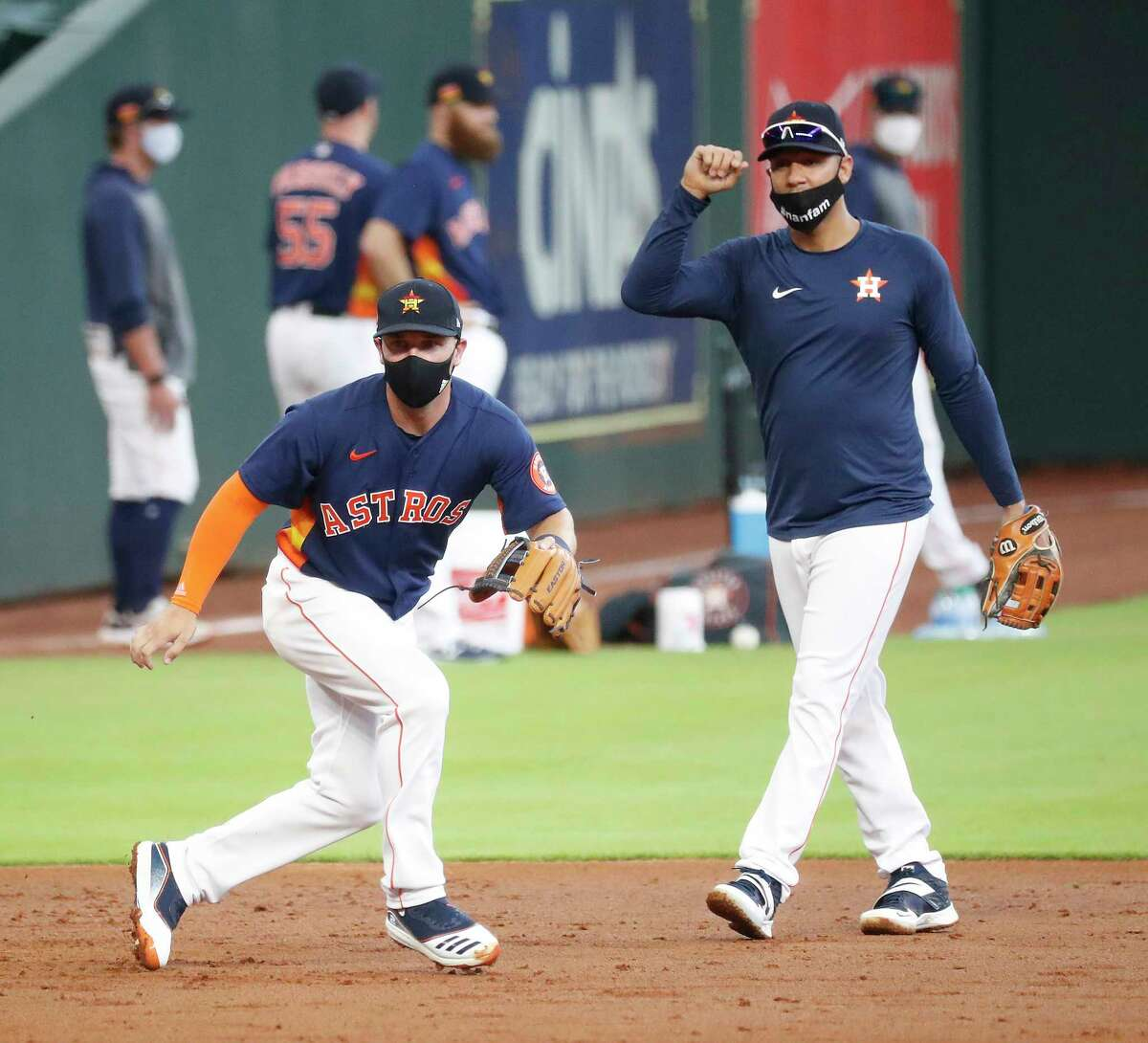 Houston Astros Alex Bregman and Yuli Gurriel work third base grounders during the Astros summer camp at Minute Maid Park, Friday, July 10, 2020, in Houston.