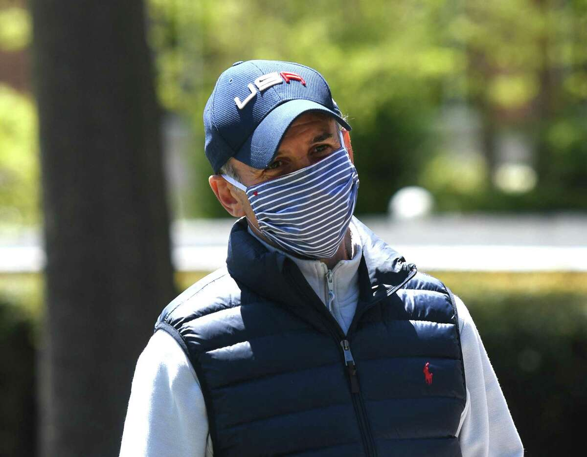 Greenwich First Selectman Fred Camillo wears a face covering outside Greenwich Hospital in Greenwich, Conn. Tuesday, May 12, 2020.