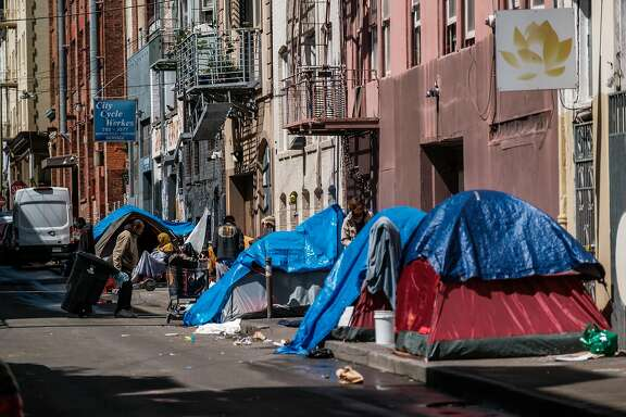 A row of homeless tents are seen in an alley way in the Tenderloin in San Francisco, Calif. on Tuesday April 7, 2020.