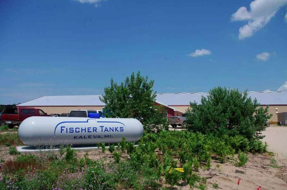 The sign at the entrance to the Fischer Tanks plant in the Kaleva Industrial Parkis painted on a newly-refurbished propane tank on July 19, 2013.Fischer Tanks was able to retain 31-33 jobs with the help of aPaycheck Protection Loan range of$350,000 to $1 million (File photo)