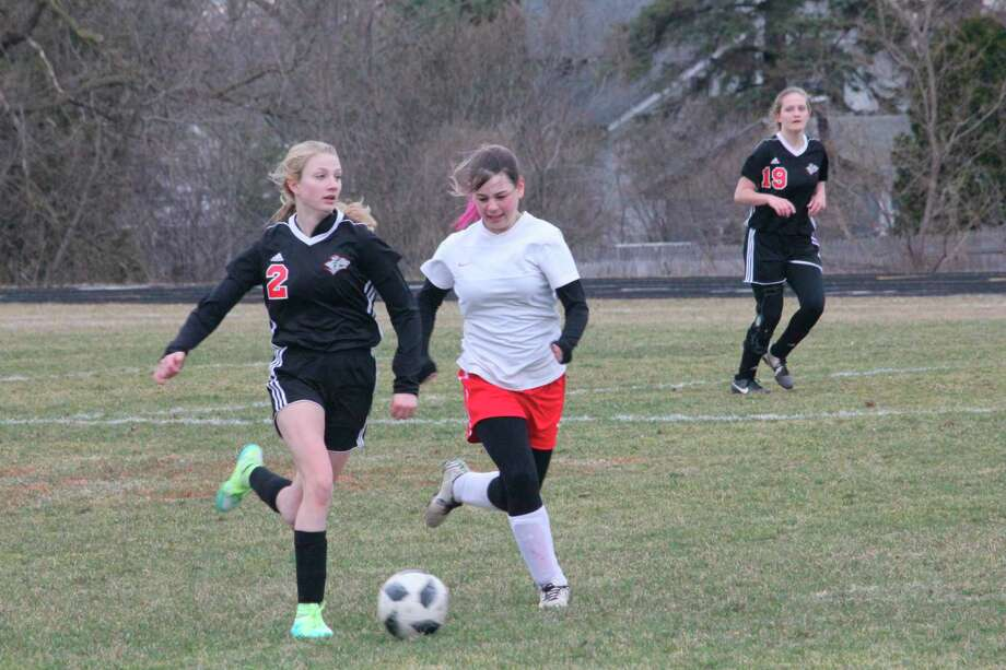 Reed City's Karlie Kearns (2) takes the ball down the field during the 2019 soccer season. Kearns would have been a senior had there been a 2020 team. (Pioneer file photo)