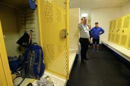 Coaches lead Stephanie and Travis Hollman on a tour of Hamshire-Fannett's existing and damaged locker facilities, giving a chance to take first measurements, following a surprise assembly at which the Longhorns learned they won the national contest held by Hollman, Inc., and would receive brand new lockers. Photo taken Monday, February 10, 2020 Kim Brent/The Enterprise