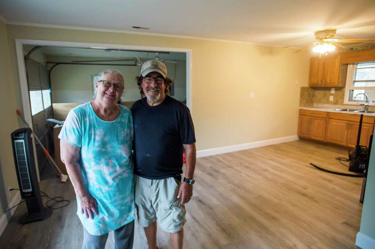 Cindy and Brian Matthias pose for a portrait Friday inside their home on Ostlund Drive in Hope, which is nearly ready for them to move back into. In the meantime, the couple is staying in an RV parked next to their house. (Katy Kildee/kkildee@mdn.net)