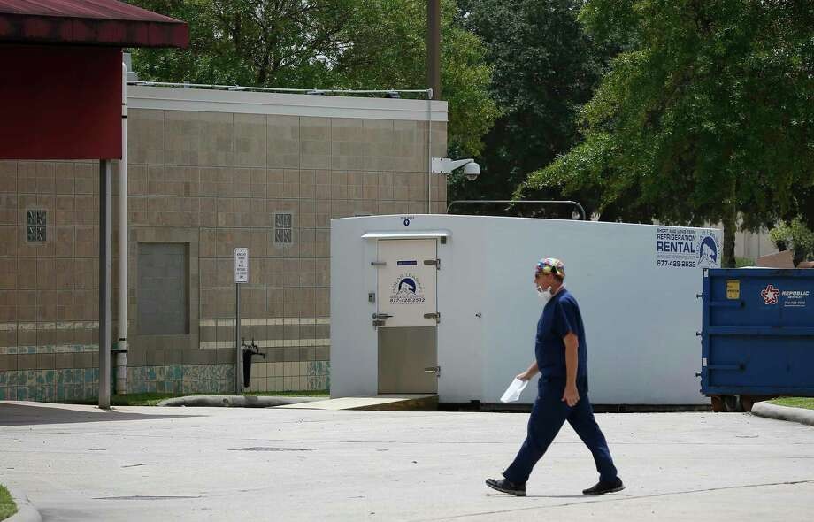 A refrigerated trailer was rolled into a loading area at HCA Healthcare Northwest when that hospital's morgue became full after a surge of COVID-19 deaths. Photographed July 1, in Houston. Photo: Steve Gonzales, Houston Chronicle / Staff Photographer / © 2020 Houston Chronicle