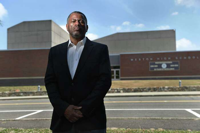 Brian Murray-Dalrymple, pictured in front of the high school on June 23, 2020, moved his family to Weston eight years ago for the excellent school system for his five children. Now he says he is frustrated by district's response to alleged racist social media posts.