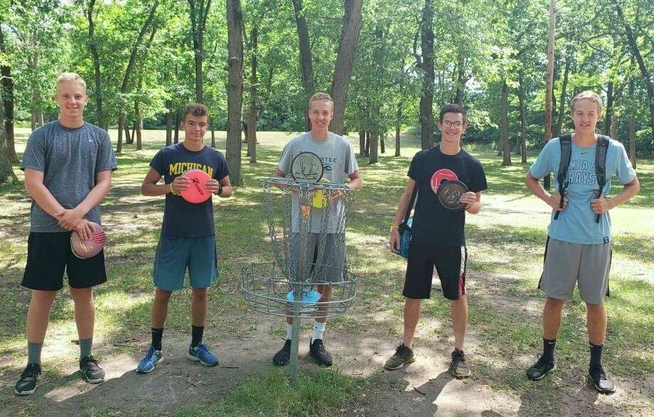 Ben Schlaff, Luke Smith, Grant Schlaff, Jack Holtgren and Drew Schlaff enjoy an afternoon of disc golf at Red Szymarek Park. Chris Stronach is hoping to bring an 18-hole disc golf course to Manistee. (Courtesy photo)
