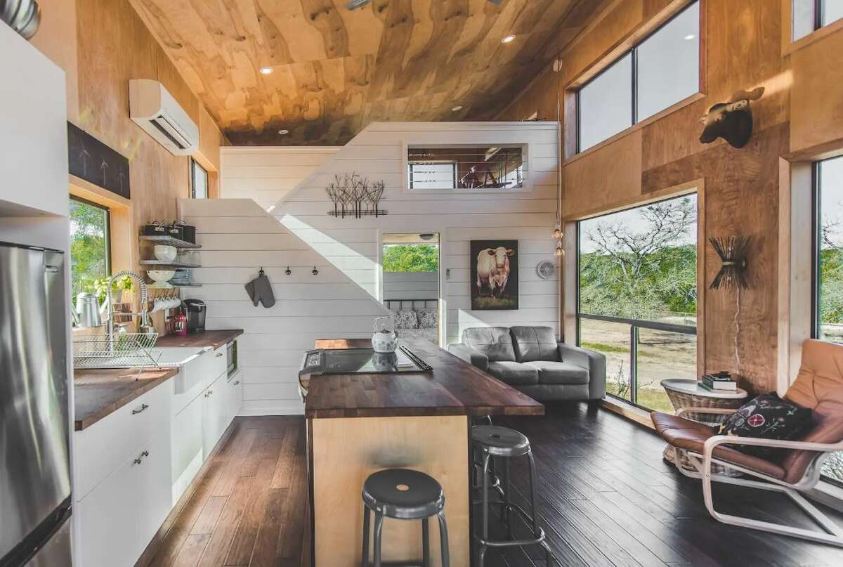 Step inside this tiny home cabin at Wanderin' Star Farms. This Airbnb host takes cleanliness seriously in light of the pandemic. The living spaces are cleaned and disinfected, and 100% of the linens are changed out for every single stay.