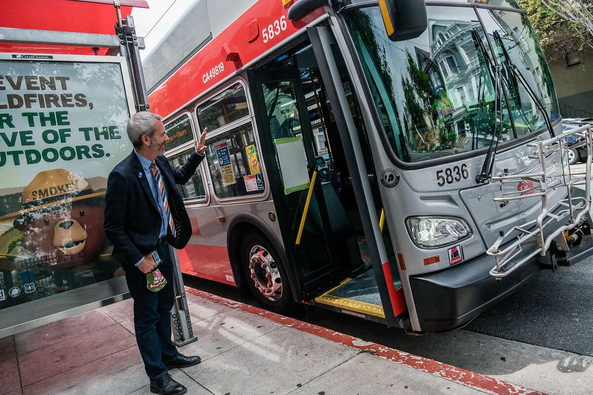 San Francisco transportation chief Jeffrey Tumlin chats with a bus driver in San Francisco on Friday, July 3, 2020.