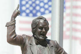 A popular Alton statue captures Stephen Douglas making a dramatic gesture while debating Abraham Lincoln Oct. 15, 1858 in Alton. Douglas' statute has come under scrutiny this week after Illinois Speaker Mike Madigan called for the removal of all Douglas artwork in Springfield.