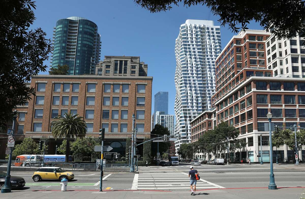 Mira tower (tallest white building at middle left) seen from the Embarcadero on Thursday, July 9, 2020, in San Francisco, Calif.