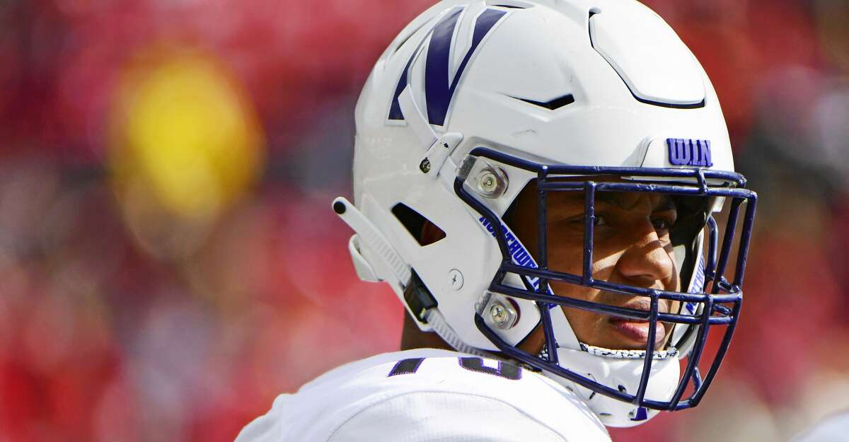 Rashawn Slater #70 of the Northwestern Wildcats looks on during a timeout against the Rutgers Scarlet Knights during the third quarter on October 20, 2018 in Piscataway, New Jersey. Northwestern won 18-15. (Photo by Corey Perrine/Getty Images)