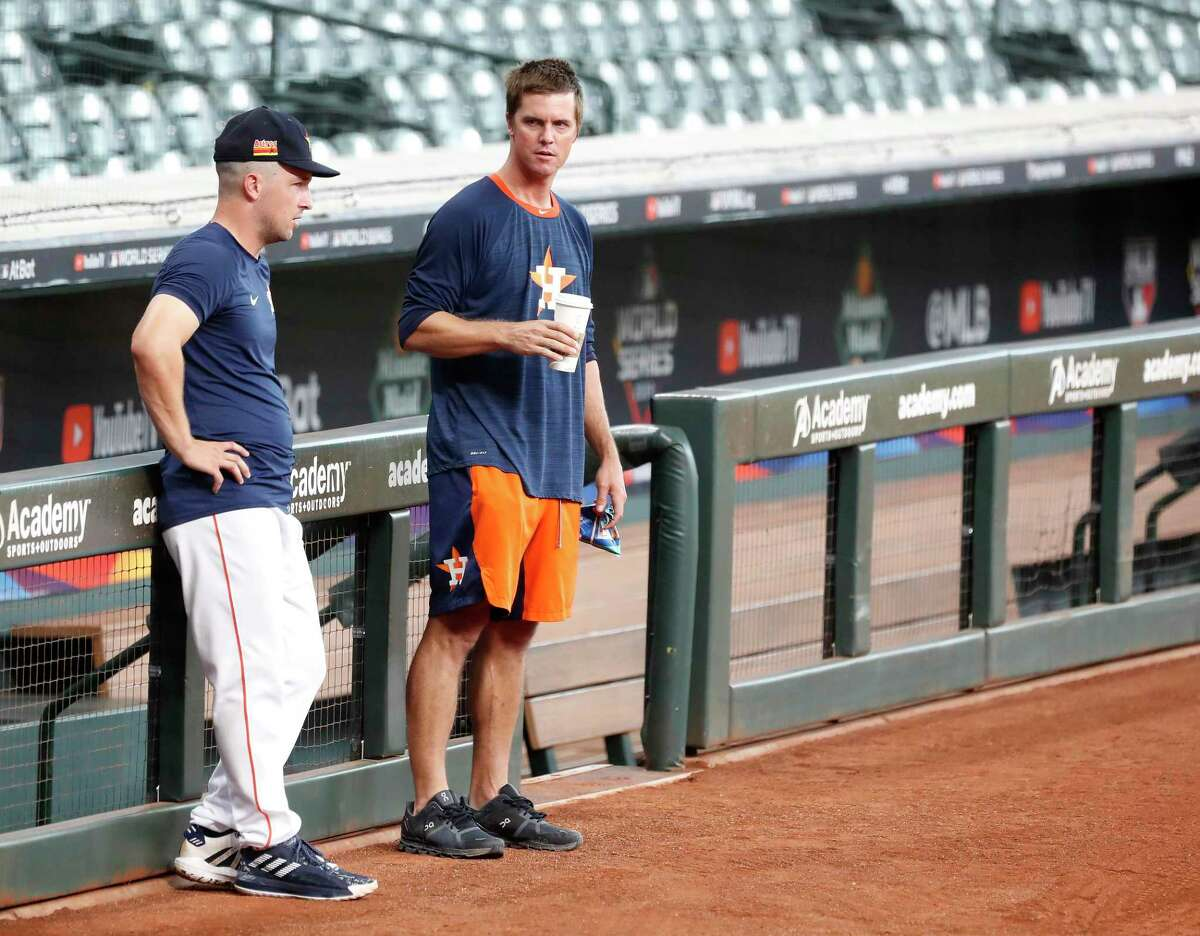 Houston Astros pitcher Zack Greinke talks with Alex Bregman during the Astros summer camp at Minute Maid Park, Friday, July 10, 2020, in Houston.