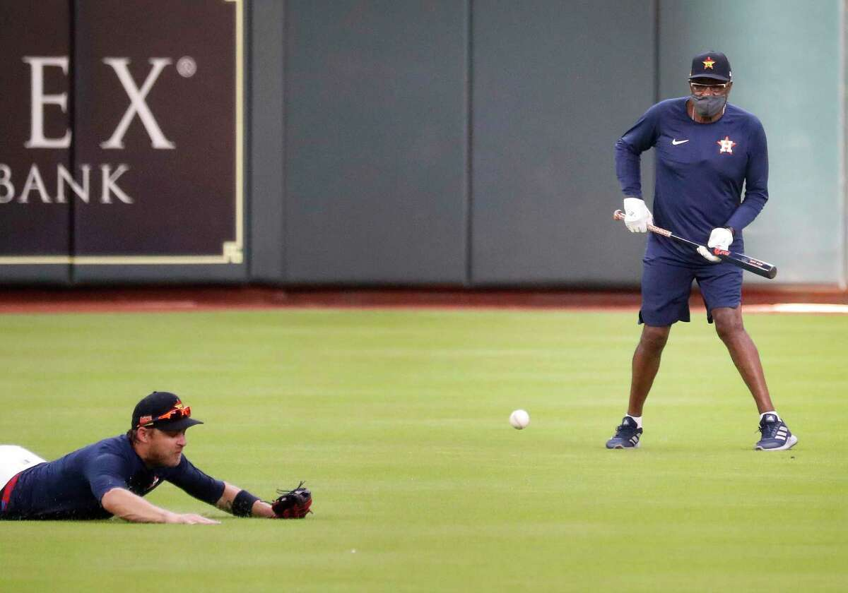 Houston Astros manager Dusty Baker watches Josh Reddick dive for a ball during the Astros summer camp at Minute Maid Park, Friday, July 10, 2020, in Houston.